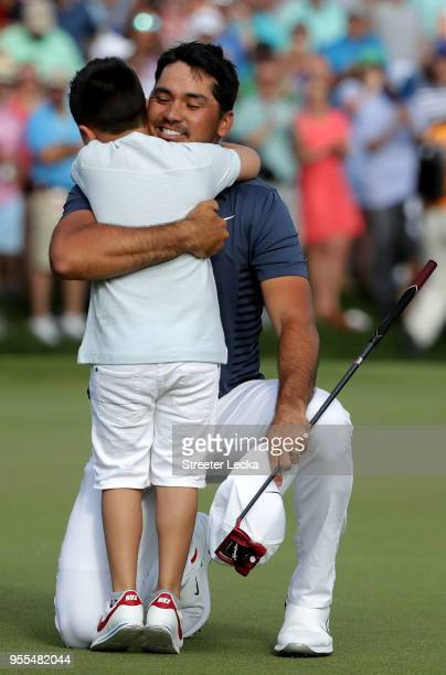 Jason Day of Australia celebrates with his son Dash on the 18th green during the final round after winning the 2018 Wells Fargo Championship at Quail...