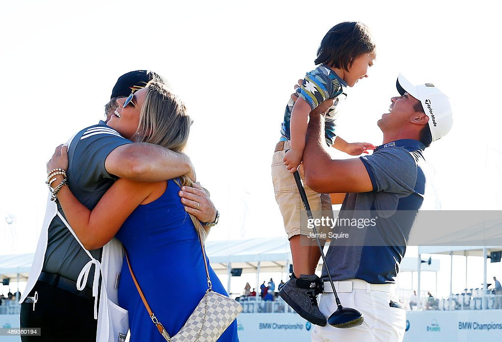 Jason Day of Australia celebrates with his son Dash, wife Ellie and caddie Colin Swatton after winning during the Final Round of the BMW Championship at Conway Farms Golf Club on September 20, 2015 in Lake Forest, Illinois.
