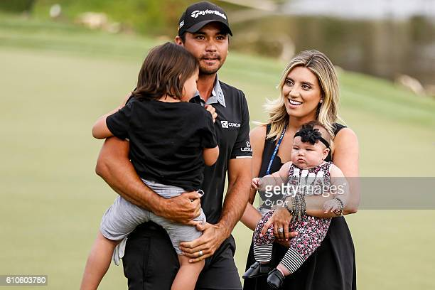 Jason Day of Australia celebrates with his wife Ellie and their kids Dash and Lucy after his victory on the 18th hole green during the final round of...