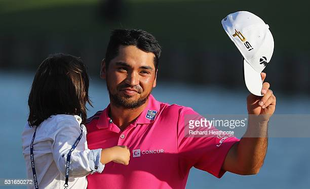 Jason Day of Australia celebrates with son Dash after winning during the final round of THE PLAYERS Championship at the Stadium course at TPC...