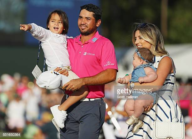Jason Day of Australia celebrates with son Dash wife Ellie and daughter Lucy after winning during the final round of THE PLAYERS Championship at the...