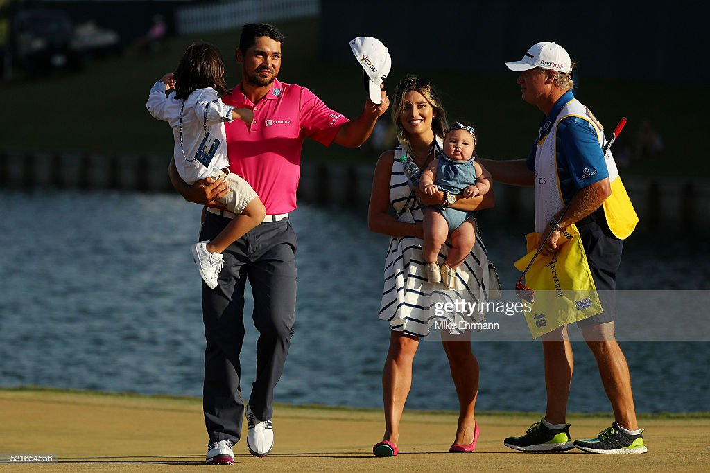 Jason Day of Australia celebrates with son Dash, wife Ellie and daughter Lucy and caddie Colin Swatton after winning during the final round of THE PLAYERS Championship at the Stadium course at TPC Sawgrass on May 15, 2016 in Ponte Vedra Beach, Florida.