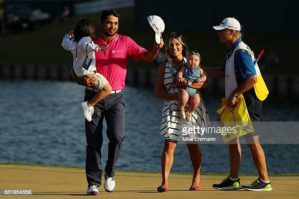 Jason Day of Australia celebrates with son Dash wife Ellie and daughter Lucy and caddie Colin Swatton after winning during the final round of THE...