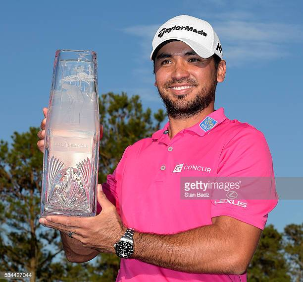 Jason Day of Australia celebrates with the trophy during the final round of THE PLAYERS Championship on THE PLAYERS Stadium Course at TPC Sawgrass on...