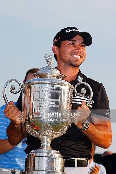 Jason Day of Australia celebrates with the Wanamaker Trophy after winning the 2015 PGA Championship with a score of 20under par at Whistling Straits...