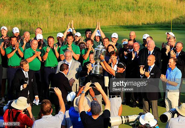 Jason Day of Australia celebrates with the Wanamaker Trophy after winning the 2015 PGA Championship with a score of 20-under par at Whistling Straits...