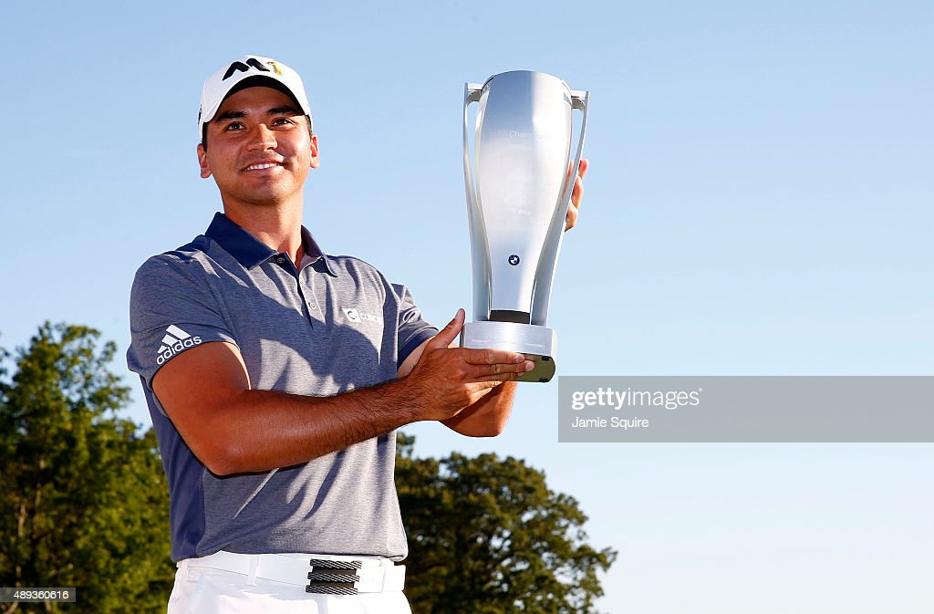 Jason Day of Australia celebrates with the winner's trophy after the Final Round of the BMW Championship at Conway Farms Golf Club on September 20, 2015 in Lake Forest, Illinois.