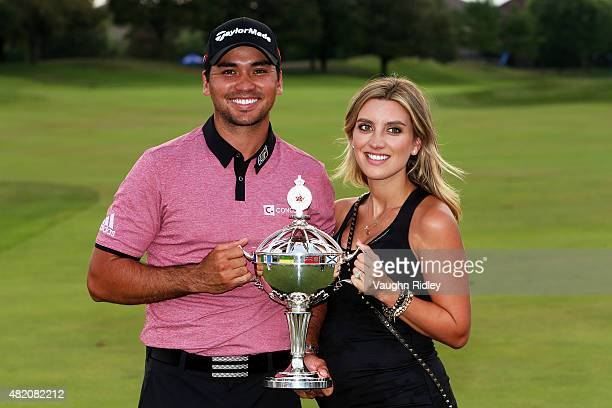 Jason Day of Australia celebrates with the winner's trophy and his wife Ellie after the final round of the RBC Canadian Open at Glen Abbey Golf Club...