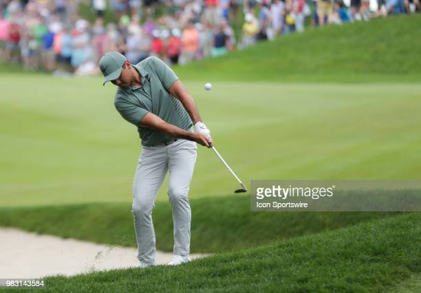 Jason Day of Australia chips a shot from the rough to birdie the 18th hole during the Final Round of the Travelers Championship on June 24 2018 at...