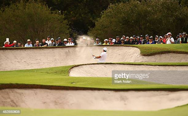 Jason Day of Australia chips out of a bunker shot during day three of the Australian Open at Royal Sydney Golf Club on November 30 2013 in Sydney...