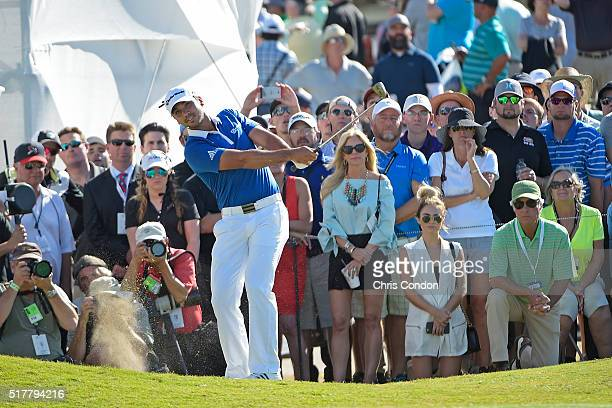 Jason Day of Australia chips to the 13th green as Ben Julie and daughter Claire Crenshaw look on during round 7 of the World Golf Championships Dell...