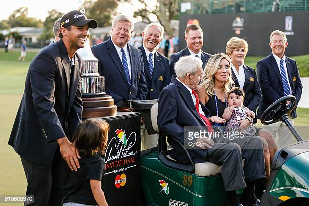 Jason Day of Australia Dash Day Arnold Palmer Ellie Day and Lucy Day share a laugh during a trophy photo call following Day's one stroke victory on...