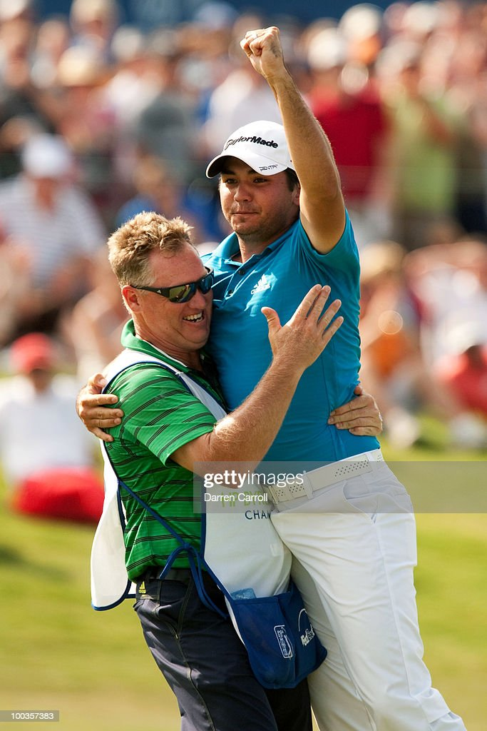 Jason Day of Australia embraces caddie Clin Swatton after winning the HP Byron Nelson Championship at TPC Four Seasons Resort Las Colinas on May 23, 2010 in Irving, Texas.