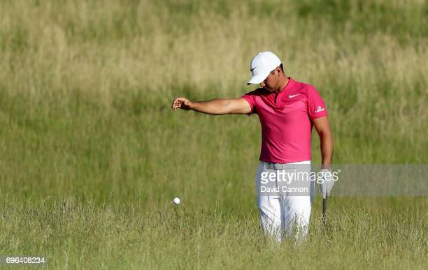 Jason Day of Australia finds his ball in the deep rough where he has to take a penalty drop on the par 4 15th hole during the first round of the...