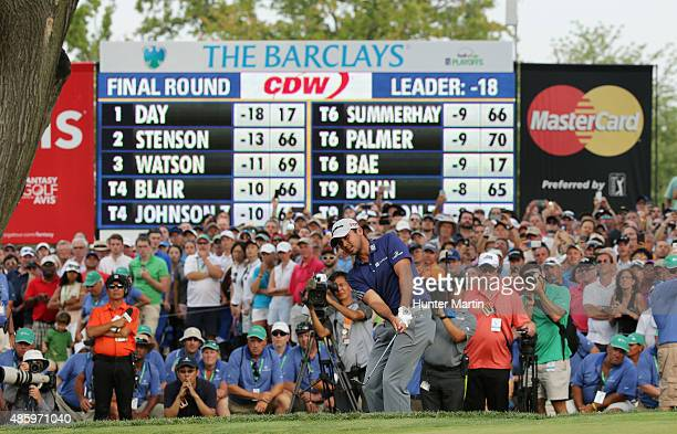 Jason Day of Australia hits a pitch shot on the 18th hole during the final round of The Barclays at Plainfield Country Club on August 30 2015 in...