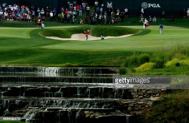 Jason Day of Australia hits a shot from a greenside bunker on the 18th hole during the third round of the 96th PGA Championship at Valhalla Golf Club...