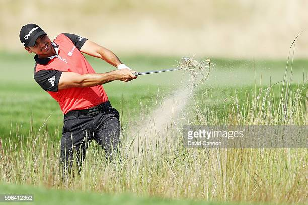 Jason Day of Australia hits a shot on the 11th hole during the third round of The Barclays in the PGA Tour FedExCup PlayOffs on the Black Course at...