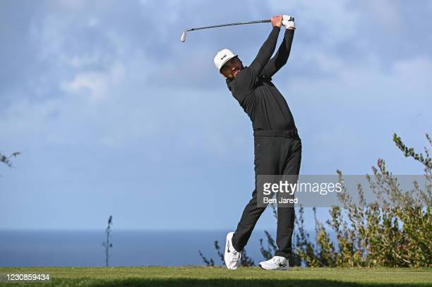 Jason Day of Australia hits a tee shot on the 12th hole north course during the second round of the Farmers Insurance Open at Torrey Pines South on...