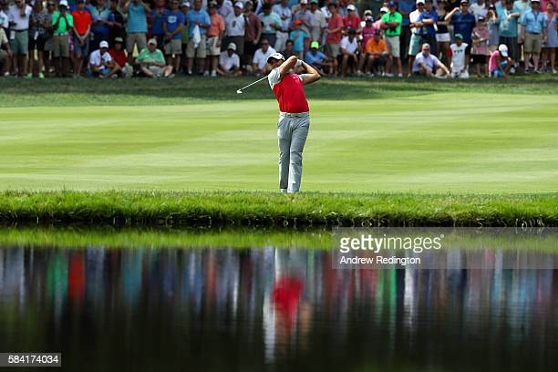 Jason Day of Australia hits an approach shot on the 18th hole during the first round of the 2016 PGA Championship at Baltusrol Golf Club on July 28...