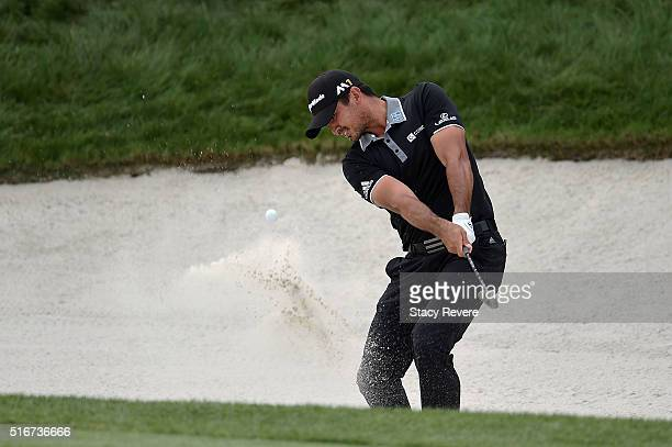 Jason Day of Australia hits from a green side bunker on the 18th hole during the final round of the Arnold Palmer Invitational Presented by...