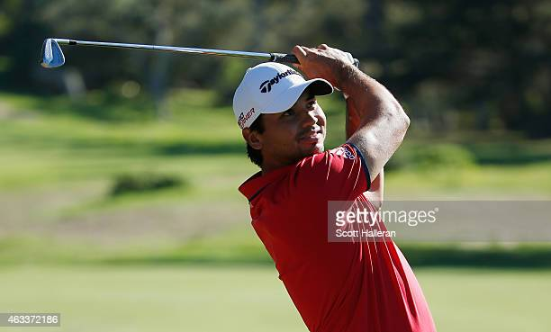 Jason Day of Australia hits his approach shot on the first hole during the second round of the ATT Pebble Beach National ProAm at the Monterey...