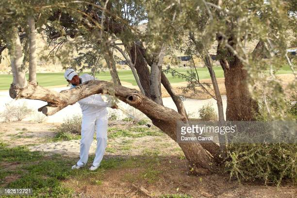 Jason Day of AUstralia hits his second shot from behind a tree on the seventh hole during the semifinal round of the World Golf Championships...