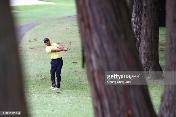 Jason Day of Australia hits his second shot on the 15th hole during the second round of the Zozo Championship at Accordia Golf Narashino Country Club...