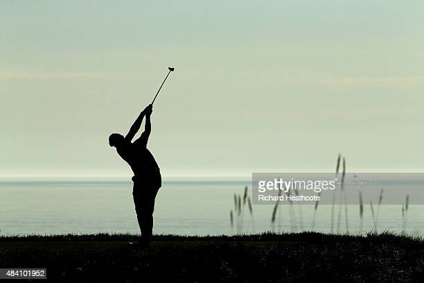 Jason Day of Australia hits his tee shot on the 18th hole during the continuation of the weather-delayed second round of the 2015 PGA Championship at...