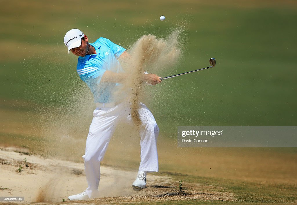 Jason Day of Australia hits his third shot from a bunker on the fifth hole during the final round of the 114th U.S. Open at Pinehurst Resort & Country Club, Course No. 2 on June 15, 2014 in Pinehurst, North Carolina.