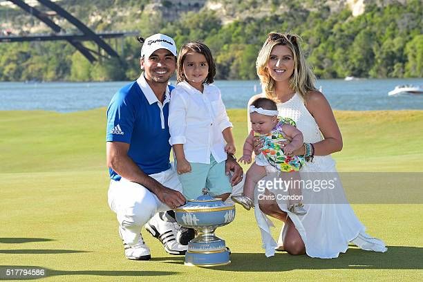Jason Day of Australia holds the Walter Hagen Cup with his wife Ellie Day and his children Lucy and Dash after winning the World Golf Championships...