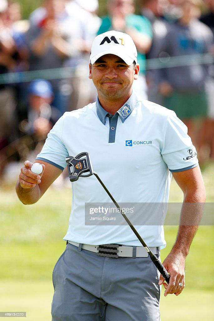 Jason Day of Australia holds up his ball after putting for birdie on the third green during the Third Round of the BMW Championship at Conway Farms Golf Club on September 19, 2015 in Lake Forest, Illinois.