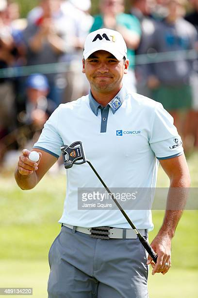 Jason Day of Australia holds up his ball after putting for birdie on the third green during the Third Round of the BMW Championship at Conway Farms...
