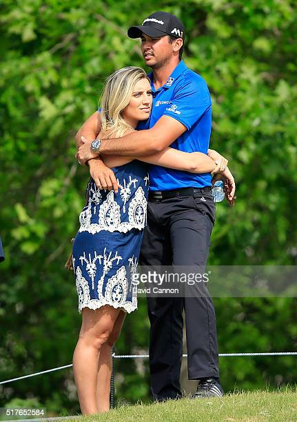Jason Day of Australia hugs his wife Ellie after winning his match against Brooks Koepka in the round of 8 in the World Golf ChampionshipsDell Match...