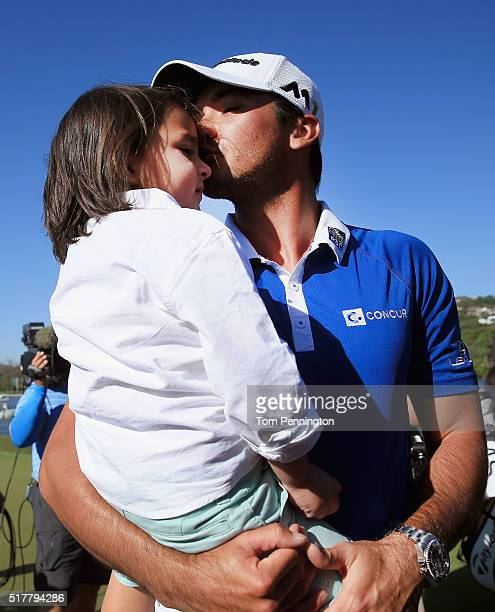 Jason Day of Australia kisses his son Dash after defeating Louis Oosthuizen of South Africa 54 in the championship match of the World Golf...