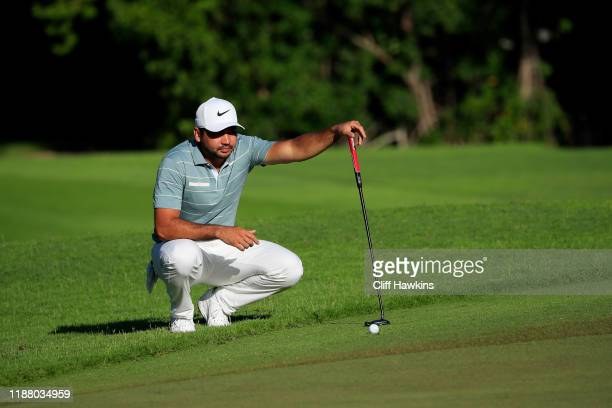 Jason Day of Australia lines up a putt on the 13th green during the second round of the Mayakoba Golf Classic at El Camaleon Mayakoba Golf Course on...