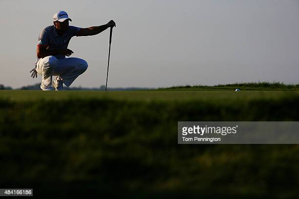 Jason Day of Australia lines up a putt on the 16th hole during the third round of the 2015 PGA Championship at Whistling Straits at on August 15 2015...