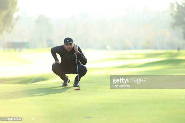 Jason Day of Australia lines up a putt on the 17th hole during the second round of the Genesis Invitational at Riviera Country Club on February 14,...