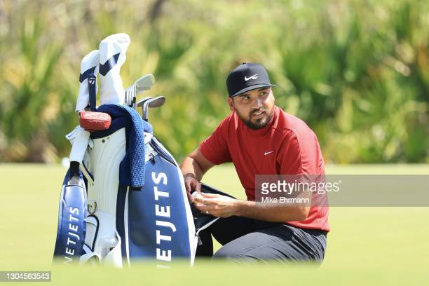 Jason Day of Australia looks on from the putting green during the final round of World Golf Championships-Workday Championship at The Concession on...