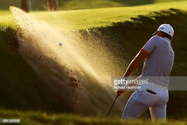 Jason Day of Australia plays a bunker shot on the 15th hole during the third round of the 2015 PGA Championship at Whistling Straits at on August 15...