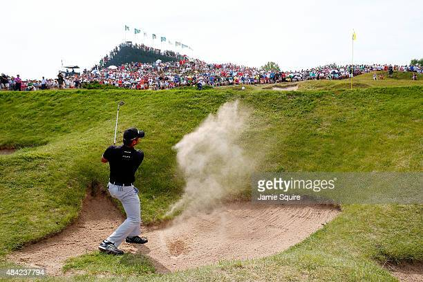Jason Day of Australia plays a bunker shot on the second hole during the final round of the 2015 PGA Championship at Whistling Straits on August 16...