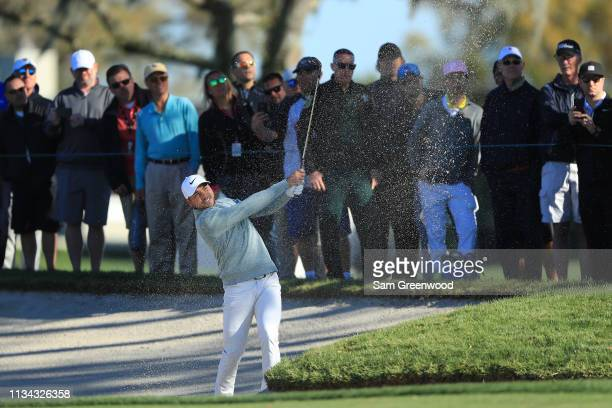 Jason Day of Australia plays a shot from a bunker as fans look on during the first round of the Arnold Palmer Invitational Presented by Mastercard at...
