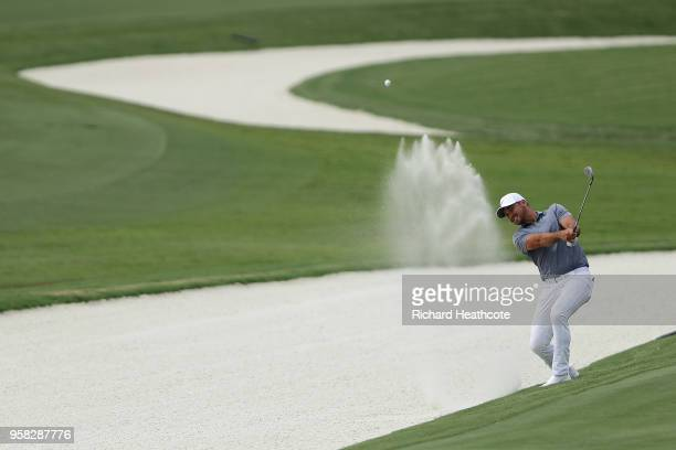 Jason Day of Australia plays a shot from a bunker on the 11th hole during the third round of THE PLAYERS Championship on the Stadium Course at TPC...