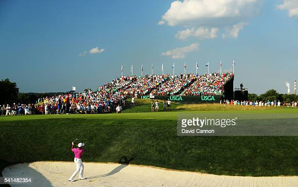 Jason Day of Australia plays a shot from a bunker on the 17th hole during the final round of the US Open at Oakmont Country Club on June 19 2016 in...