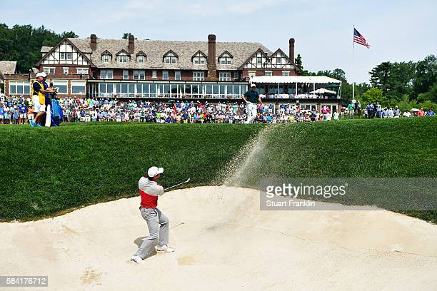 Jason Day of Australia plays a shot from a bunker on the 18th hole during the first round of the 2016 PGA Championship at Baltusrol Golf Club on July...