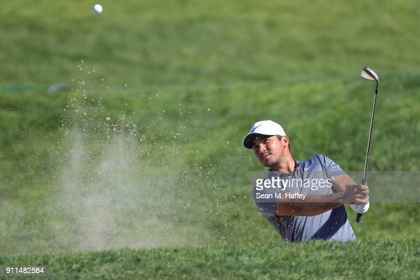 Jason Day of Australia plays a shot from a bunker on the ninth hole during the final round of the Farmers Insurance Open at Torrey Pines South on...