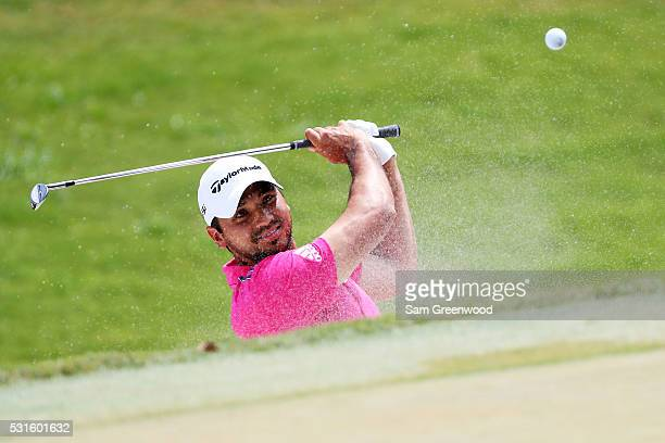 Jason Day of Australia plays a shot from a bunker on the third hole during the final round of THE PLAYERS Championship at the Stadium course at TPC...