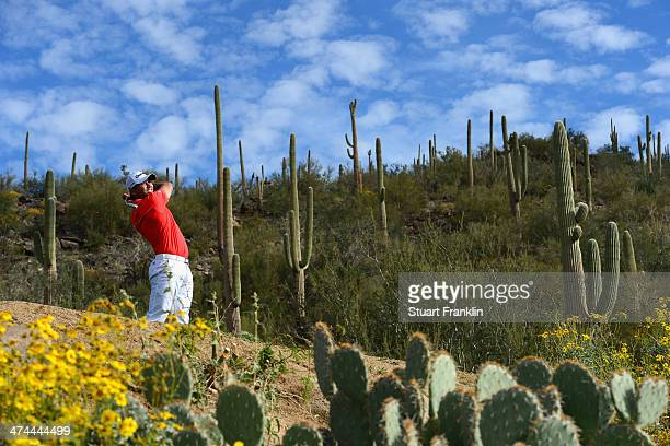 Jason Day of Australia plays a shot on the 12th hole during the semifinal round of the World Golf Championships Accenture Match Play Championship at...