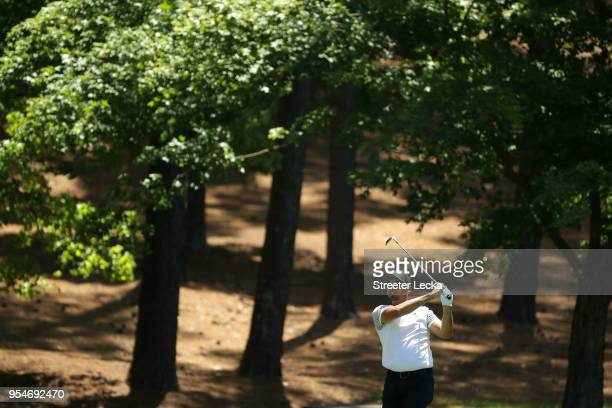 Jason Day of Australia plays a shot on the second hole during the second round of the 2018 Wells Fargo Championship at Quail Hollow Club on May 4...