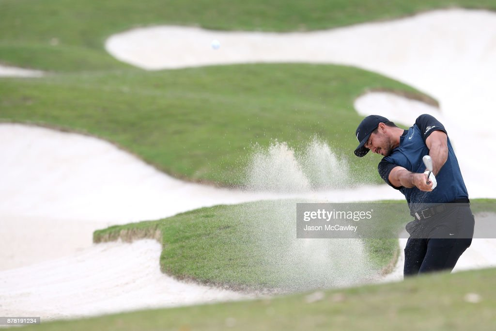 Jason Day of Australia plays an approach shot from the bunker on the 18th hole during day two of the 2017 Australian Golf Open at the Australian Golf Club on November 24, 2017 in Sydney, Australia.