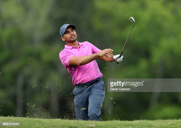Jason Day of Australia plays his second shot on the par 4 14th hole during the final round of the THE PLAYERS Championship on the Stadium Course at...